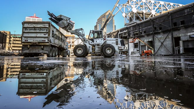 Heavy equipment loads steel beams into a waiting truck at the Kentucky International Convention Center.  Much of the steel and concrete and other items are being recycled as part of the project.December 1, 2016