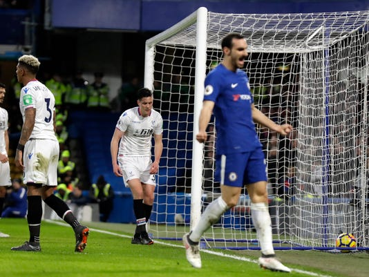 Crystal Palace's Martin Kelly, center, reacts after scoring an own goal during the English Premier League soccer match between Chelsea and Crystal Palace at Stamford Bridge stadium in London, Saturday, March 10, 2018. (AP Photo/Matt Dunham)