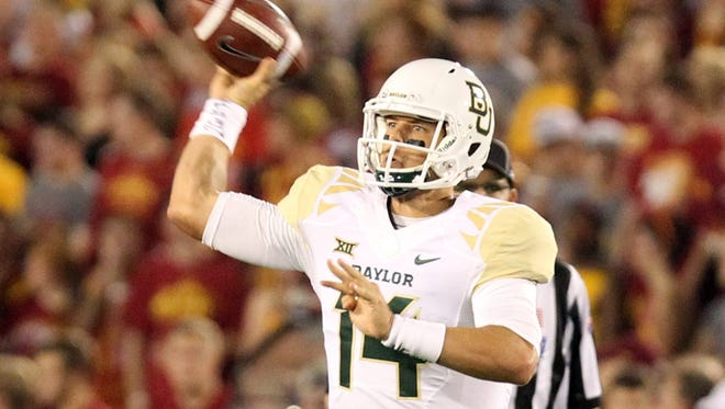 Baylor Bears quarterback Bryce Petty (14) throws a pass agains the Iowa State Cyclones at Jack Trice Stadium.