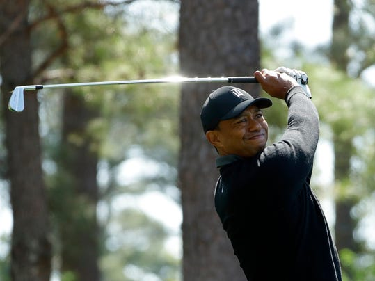 FILE - In this April 5, 2018, file photo, Tiger Woods hits a shot on the fourth hole during the first round at the Masters golf tournament in Augusta, Ga. Woods has filed his entry to play in the U.S. Open for the first time since 2015. The USGA says Woods officially entered on Thursday, April 12, 2018, four days after he tied for 32nd in the Masters.(AP Photo/Matt Slocum, File)