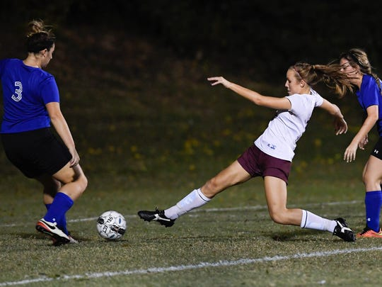 Henderson's Maddie Griggs splits Crittenden County defenders Meredith Evans (left) and Emily Tinsley to score one of her first period goals as the 11th-ranked Henderson County Lady Colonels play Crittenden County in the first round of the Second Region Girls Soccer Tournament Monday at Colonel Field, October 17, 2016.
