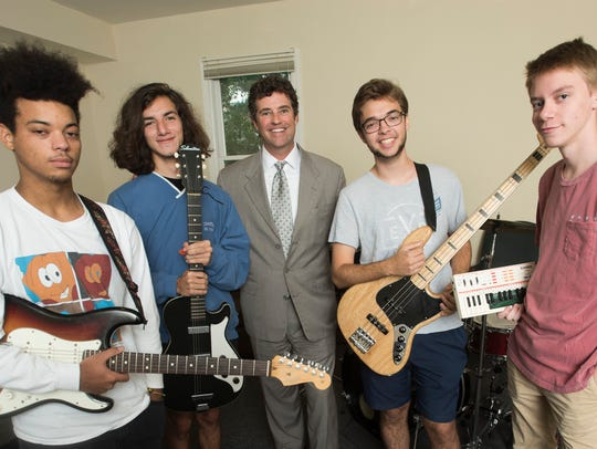 Attorney Christopher Klotz mentors Devin Thomas, Matthew Masuca, Adam Davis and Mac Wilson, who make up the band The Juice Is Okay.