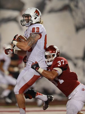 Ball State's TE Zane Fakes catches a touchdown pass as IU's Mark Murphy,#37, attempts to defend in the third quarter of their game Saturday evening at Memorial Stadium in Bloomington. Saturday, September 15, 2012.