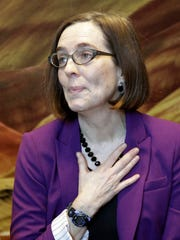 Oregon Secretary of State Kate Brown listens to comments from speakers during a celebration at the Oregon Historical Society to mark the 156th anniversary of Oregon's admission to the union as the 33rd state. She will be sworn in as Oregon's 38th governor Wednesday morning.