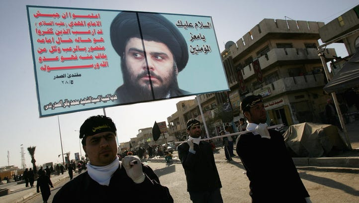 Iraqi supporters of Shiite cleric Moqtada al-Sadr carry