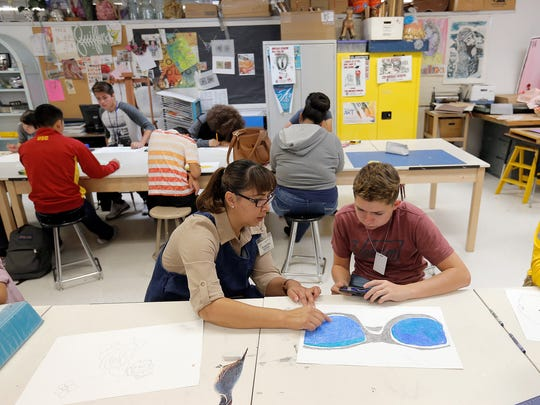 Eastwood High School art teacher Angelica Quillin works with Anthony Palomino Wednesday.