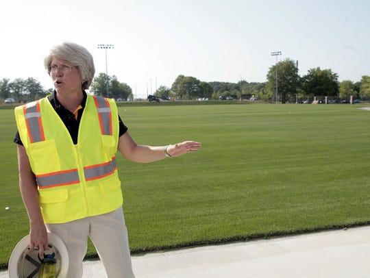 Jane Meyer leads a tour of the Iowa Hawkeye football