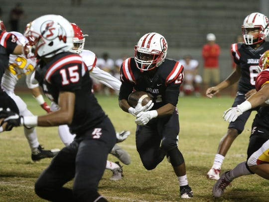 Palm Springs' Kelton Johnson runs the ball during the first half of the game against Palm Springs on Friday, October 13, 2017.