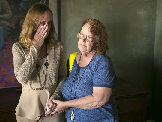 Michelle Calderon (left), of Tucson, cries as she is comforted by her mother, Barbara, in Calderon's attorney, Lynne Cadigan's Tucson office on Feb. 22, 2017. Calderon's daughter was taken away because of her drug abuse. The daughter was severely burned by her adopted mother from scalding hot water. The daughter was also previously placed with a different foster father who is now imprisoned for sex-crimes against children. Calderon's parental rights were terminated in 2015 and she has not been granted permission to see her daughter in the hospital as she recovers from her burns.