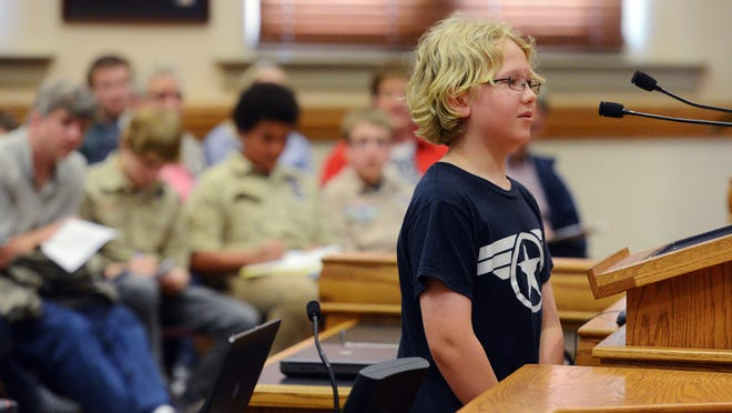 Michael Pagone, 10, speaks in favor of allowing free fixed rout bus rides for youths during a special meeting of the Sioux Falls City Council on Tuesday. The program was approved.