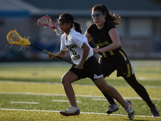 Green Bay United Girls Lacrosse player Emily Peterson (31) makes a move upfield in the first half against Appleton at Green Bay Southwest High School on Monday.