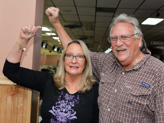 Sue and Ralph Tetrick cheer for their teammates at the Sarah's Kitchen Bowl-a-thon at Saint Lucie Lanes.