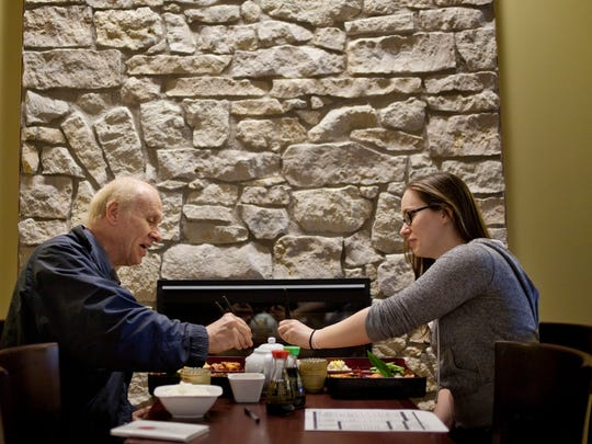 Tim Molloy, of Sarnia, has lunch with his daughter Lynn Molloy Thursday at Kitano Japanese Cuisine in Sarnia.