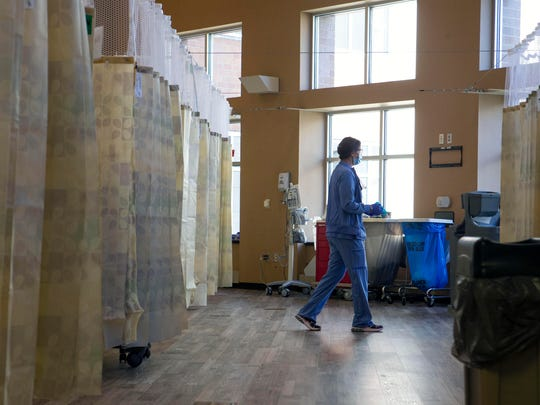 Staff members monitor patients in a corridor of Stormont Vail Health on Wednesday in Topeka, Kan. The hospital has devoted an entire floor to COVID-19 patients as their numbers swelled, hitting 90 on Wednesday.