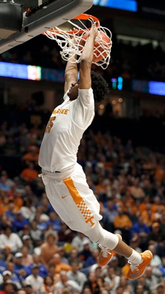 Tennessee's Detrick Mostella (15) dunks against Auburn during the first half of an NCAA college basketball game in the Southeastern Conference tournament in Nashville, Tenn., Wednesday, March 9, 2016. (AP Photo/John Bazemore)