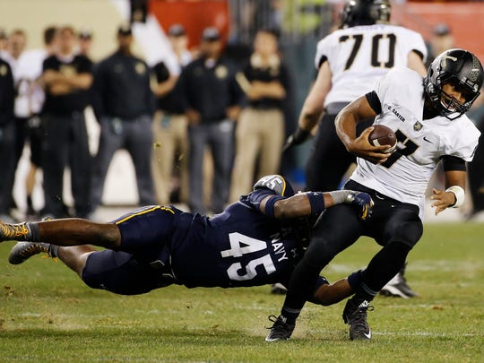 Army quarterback Chris Carter (7) is tackled by Navy linebacker D.J. Palmore (45) during the second half of an NCAA college football game Saturday, Dec. 12, 2015, in Philadelphia. (AP Photo/Matt Slocum)