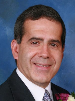Albert Pinho was named Naveo Credit Union's Senior Vice President and Senior Lender.