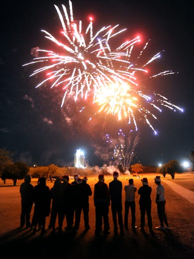 Members of the Sweetwater Mustangs watch a fireworks