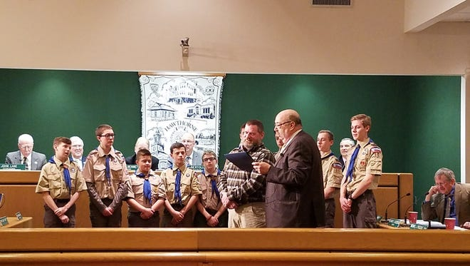 Assistant Scoutmaster Doug Gurriell joined by members of Troop 85 receives his award from Mayor Richard Goldberg.