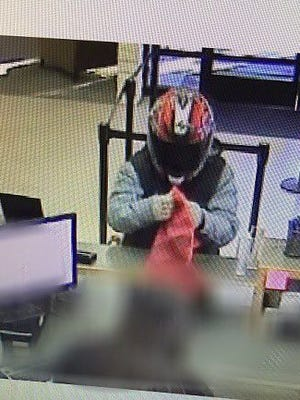 Police seek bank robbery suspect