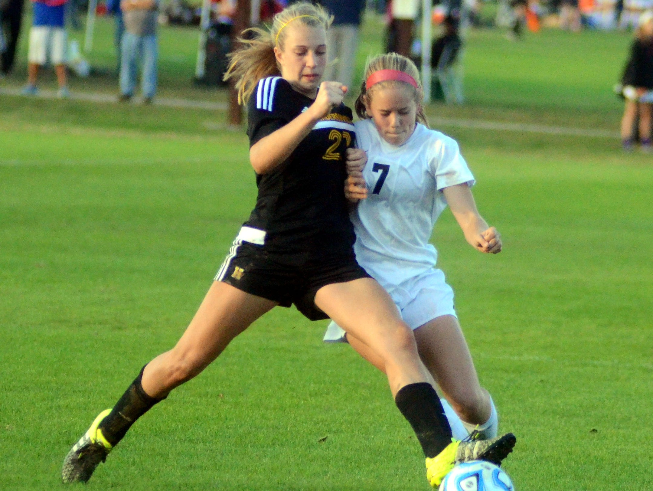 Hendersonville sophomore Brooke Long (21) battles for possession with Houston sophomore Bailey Rose during first-half action at the Class AAA State Soccer Tournament Thursday. Houston won 5-0.