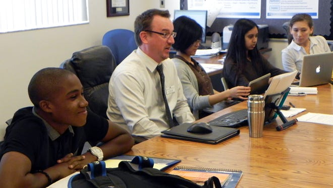 English teacher Brian Kopp, center, leads seniors in an Advanced Placement literature class Thursday at Canterbury School in Fort Myers. Canterbury celebrated its Founder's Day on Thursday, the 50th anniversary of Florida officially recognizing the school.