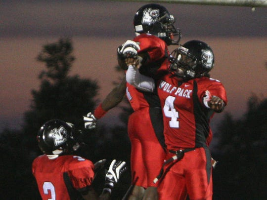 South Fort Myers quarterback Dallas Crawford and receiver Sammy Watkins celebrate their touchdown along with Tyrell Blanks, left, in the endzone during the first half against Gulf Coast on Friday, October 2, 2009, in south Fort Myers.
