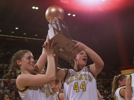 Jessica DePalo (left) and Tara McCaig raise Tournament of Champions trophy after win over Toms River North in 2000.