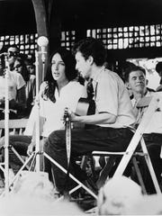 Joan Baez and Bob Dylan perform at the Newport Jazz Festival in Newport, R.I. in 1963.