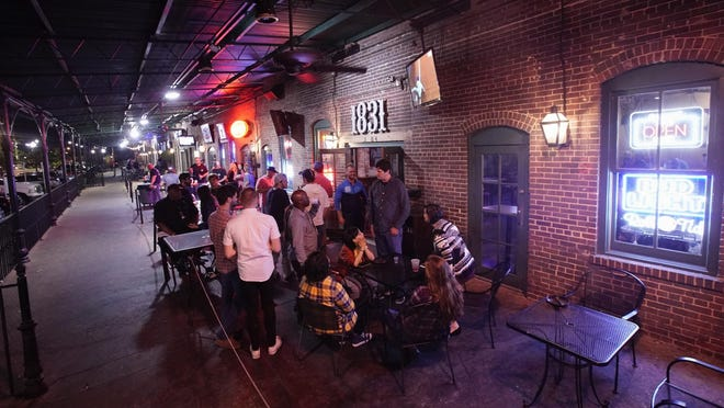 Under new executive powers granted to Tuscaloosa Mayor Walt Maddox, bars like these seen in Temerson Square in this file photo from 2018, will be limited to 50 percent occupancy in an effort to stem the growth of COVID-19.