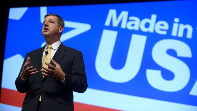 In this 2013 photo, Wal-Mart U.S. President and CEO Bill Simon addresses attendees of the Wal-Mart U.S. Manufacturing Summit in Orlando, Fla. Wal-Mart on Thursday, July 24, announced it is replacing Simon with Wal-Mart Asia CEO Greg Foran in what could be an indication that the company is losing confidence that its largest business unit will rebound after more than a year of disappointing results.