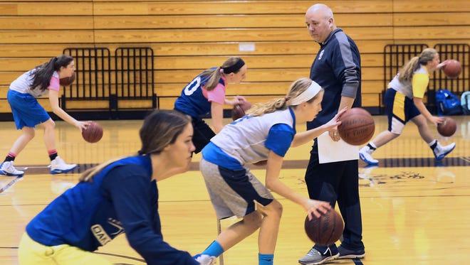 Oak Creek girls basketball coach Steve Hluchnik oversees team drills during a practice last week.