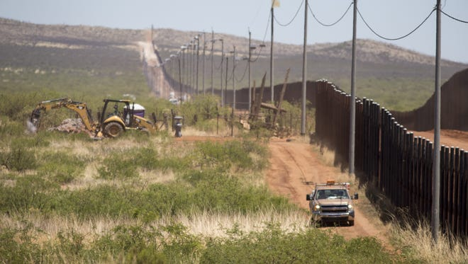 """Honing in on the cost of President Donald Trump's """"big, beautiful wall"""" is difficult, primarily because he has offered shifting estimates and conflicting details."""
