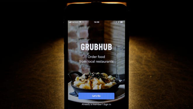 This Tuesday, Feb. 20, 2018, photo shows the Grubhub app on an iPhone in Chicago. More fast-food companies have been offering delivery by teaming up with food ordering apps.
