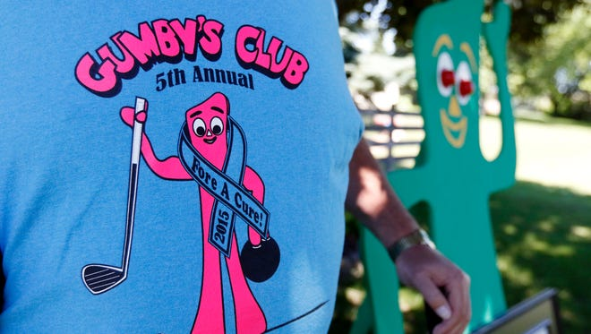 """Rob """"Gumby"""" Roseff wears a Gumby's Club t-shirt from last year's event in his backyard on Friday, June 24. Roseff and his wife, Denise, started the Gumby's Club For A Cure annual fundraiser event, which includes golf outing, bowling tournament and silent auction, to raise money to help local families that are affected by cancer."""