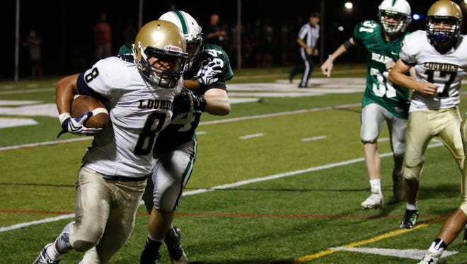 Our Lady of Lourdes High School's Estefano Rendon shed a Brewster defender on Friday in Brewster.