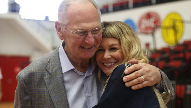Dave Loos and his daughter-in-law Jaime Valentine hug following the retirement press conference for Loos on Monday, March 6.