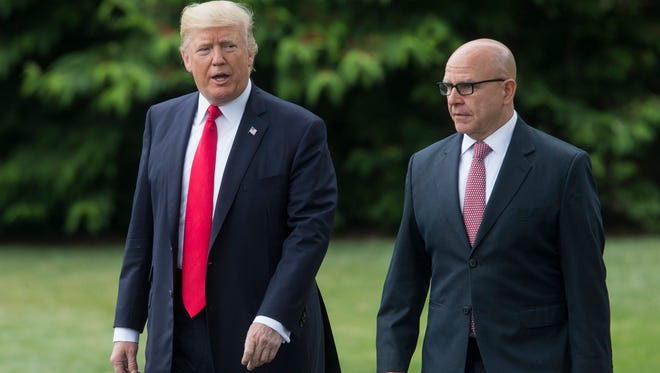 President Trump and National Security Advisor H.R. McMaster are pictured walking across the White House's South Lawn.
