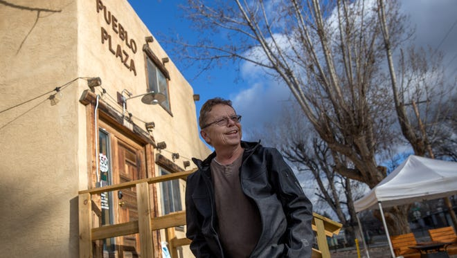 In a file photo from Wednesday, Jan. 18, 2017, Mike Paschall, owner of 550 Brewing stands in front of his bar's location at The Aztec Hub located at 119 East Chuska Street in Aztec.