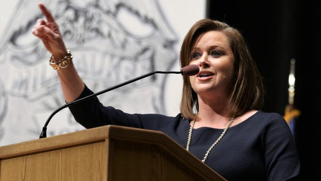 Michele McCormack, then a reporter-anchor at WDJT-TV (Channel 58), is the mistress of ceremonies at the semi-annual Merit Awards Ceremony at the Police Training Academy in Milwaukee on May 9, 2017.
