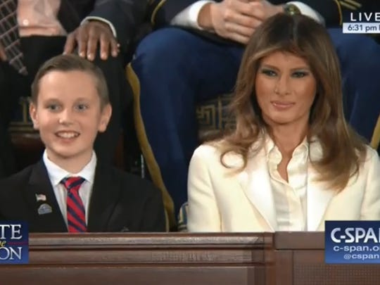 Preston Sharp sits next to First Lady Melania Trump during President Trump's State of the Union address Tuesday night.