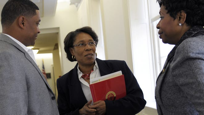 Rep. Marcia Fudge, D-Ohio, center, talks with Rep. Cedric Richmond, D-La., left, and Rep. Yvette Clarke, D-N.Y., in November after a meeting in which she was named chairwoman of the Congressional Black Caucus.