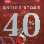 A sale sign is advertised in a store along Market street Sunday, Nov. 22, 2015, in San Francisco.