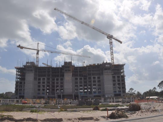 Cranes are now part of the landscape along Vanderbilt Drive as Kalea Bay rises next to a new tower at Aqua.
