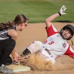 Lauren Schiek (3) of Lourdes is tagged out at second base. The Lourdes Academy Lady Knights hosted the Princeton Tigers Thursday evening at Tiedemann Field.