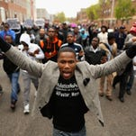 BALTIMORE, MD - APRIL 22: Hundreds of demonstrators march toward the Baltimore Police Western District station during a protest against police brutality and the death of Freddie Gray in the Sandtown neighborhood April 22, 2015 in Baltimore, Maryland. Gray, 25, was arrested for possessing a switch blade knife April 12 outside the Gilmor Homes housing project on Baltimore's west side. According to his attorney, Gray died a week later in the hospital from a severe spinal cord injury he received while in police custody. (Photo by Chip Somodevilla/Getty Images)