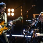 The Edge, left, and Bono of U2 perform at the Innocence & Experience Tour at The Forum in Inglewood, Calif.