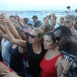 Thousands of people join hands during a walk to show unity across the Arthur Ravenel Jr. Bridge  in Charleston, S.C.
