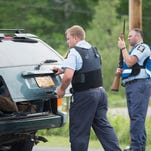 Department of Correction officers man a roadblock on Saturday in Malone. N.Y.