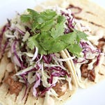Pork belly tacos with spicy cilantro sour cream, white cheddar and tangy slaw from Rivue Restaurant chef Dustin Willett. July 9, 2015